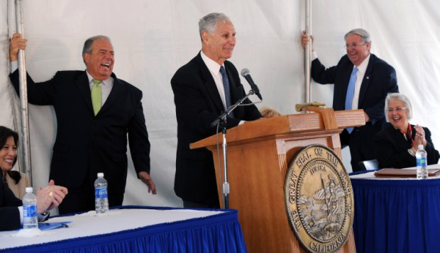 From left to right, Chief Justice of California Tani Cantil-Sakauye, Long Beach Mayor Bob Foster, former California Governor George Deukmejian, L.A. County Supervisor, 4th district, Don Knabe and State Assemblywoman Bonnie Lowenthal share a laugh during the groundbreaking ceremony for the George Deukmejian Courthouse in Long Beach Thursday April, 7,2011. Foster and Knabe hang onto tent poles to help keep the tent from blowing over during high wind gusts. The $490 million, 31-courtroom courthouse is expected to be finished by late 2013. (Staff File Photo)