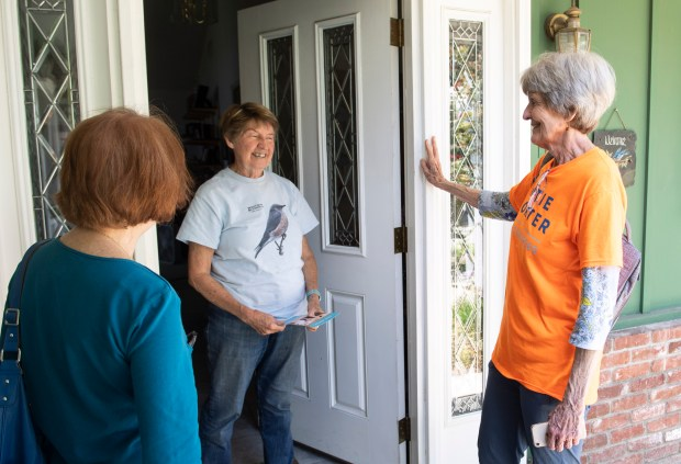 Anita Ford, 70, left, and Phyllis Steele, 73, talk with Orange resident Jo-Ann Coller while they were out canvassing for a congressional candidate on Thursday, May 10, 2018. The pair had 18 houses to visit on this day. (Photo by Paul Bersebach, Orange County Register/SCNG)