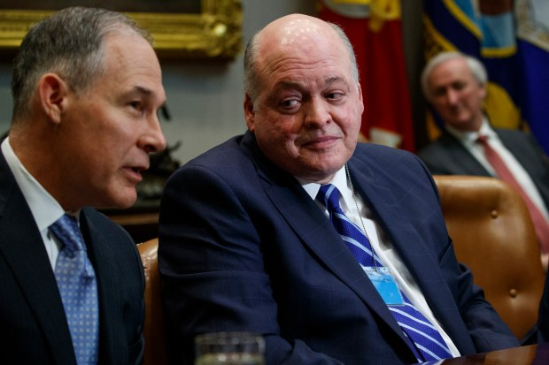 Ford CEO James Hackett, right, listens as Environmental Protection Agency administrator Scott Pruitt speaks during a meeting between President Donald Trump and automotive executives in the Roosevelt Room of the White House, Friday, May 11, 2018, in Washington. (AP Photo/Evan Vucci)