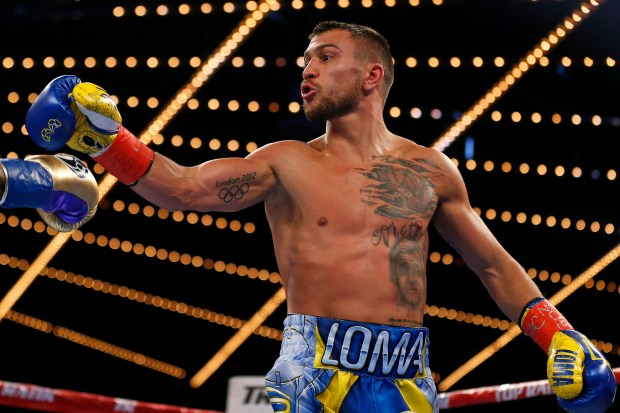 Vasyl Lomachenko, seen reacting toward Guillermo Rigondeaux at the end of the second round of their junior lightweight title match in December, has made his last four opponents quit. (Adam Hunger/The Associated Press)