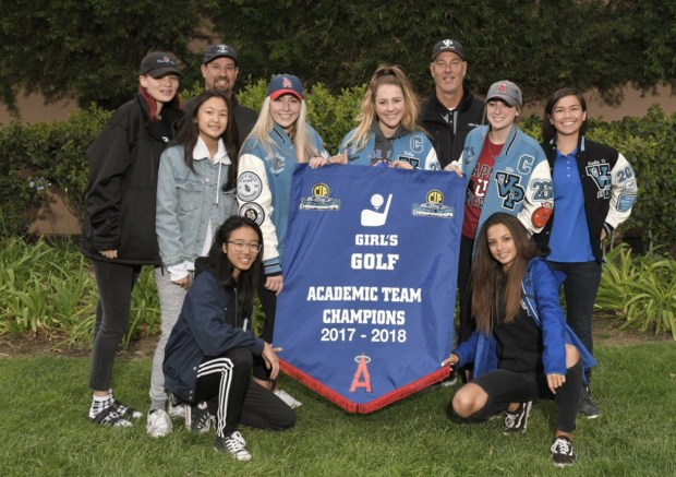 The Villa Park High girls varsity golf team, center from left, Maleah Kammerlohr, Kristin Lam, Sydney Chandler, Kelly Bryan, Ellie Wilson, Emilie Nguyen, and front, Melody Nguyen and Lenna Lazarre, with Head Coach Chris Salio and Assistant Coach Mark Kammerlohr, were honored at Angel Stadium for academic achievement. (Courtesy of the OUSD Communications Lab)