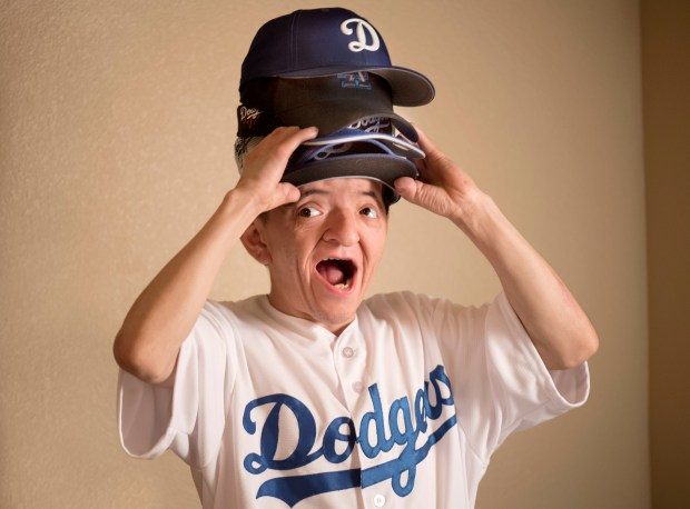 At the drop of a hat, the community rallied around Michael Cadena, 27, after news broke that the special needs Riverside resident was bullied and his Dodgers hat was stolen. Strangers gifted him Dodgers tickets for five games, baseball caps and memorabilia. (Photo by Cindy Yamanaka, The Press-Enterprise/SCNG)