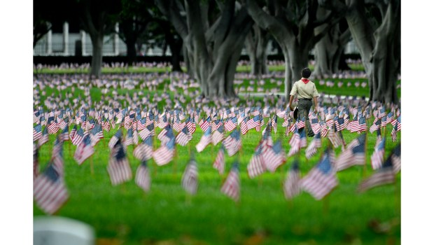 Scouts and other volunteers placed American flags on graves in 2017 at Los Angeles National Cemetery in honor of Memorial Day. (File photo by John McCoy/Los Angeles Daily News)
