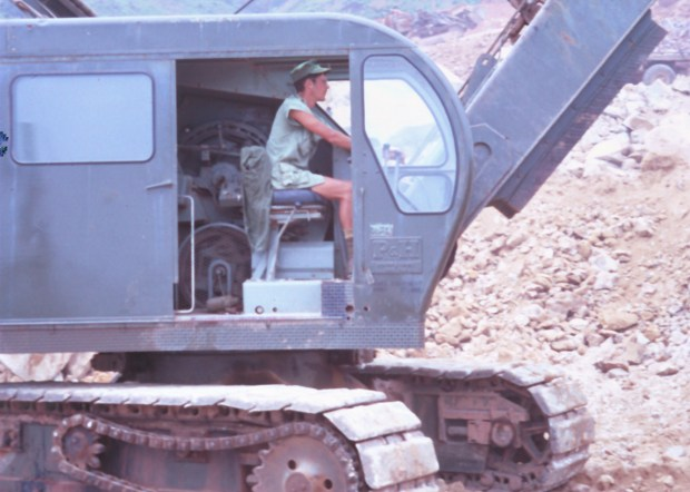 Rick King operating a power shovel while building Highway 1 in Vietnam. (Courtesy Rick King)