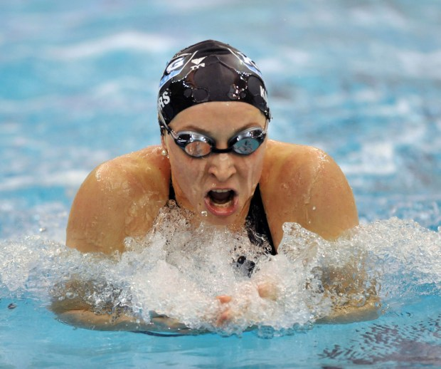 Ariana Kukors swims to win the Women's 200-yard breaststroke finals during the 2008 USA Swimming Short Course National Championships in 2008. Kukors Smith has sued USA Swimming, alleging the sport's national governing body knew her former coach sexually abused her as a minor and covered it up.. (AP File Photo/Gregory Smith, File)