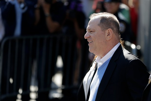 Harvey Weinstein leaves the first precinct of the New York City Police Department after turning himself to authorities following allegations of sexual misconduct, Friday, May 25, 2018, in New York. (AP Photo/Julio Cortez)
