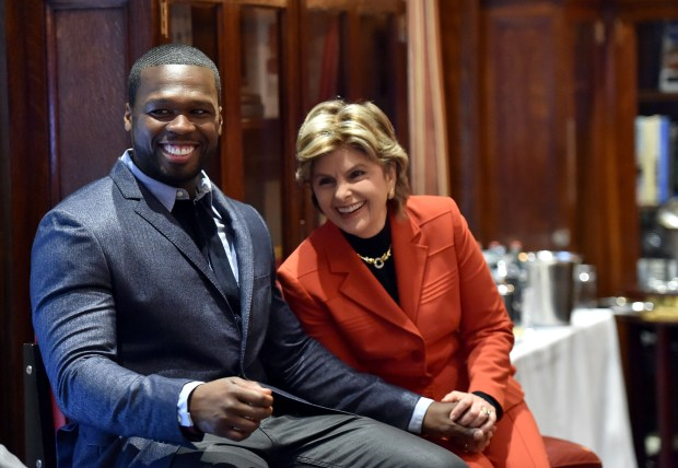 """Curtis """"50 Cent"""" Jackson is seen with attorney Gloria Allred in a 2014 photo. (Photo by Mike Coppola/Getty Images for Sundance TV)"""