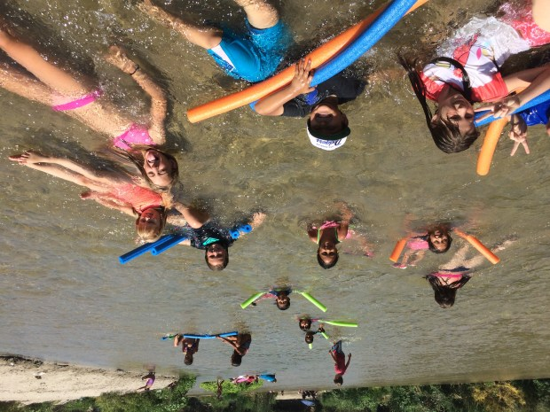Students on an educational trip to the Santa Ana River organized by Inland Empire Waterkeeper take a moment to cool off. Photo courtesy of Inland Empire Waterkeeper