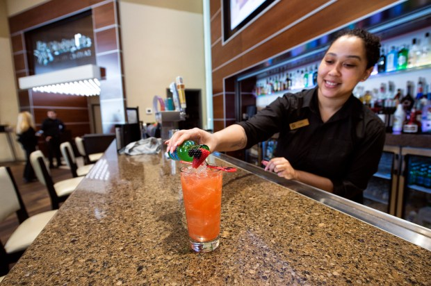 "Bartender Latashia Parker pours a ""Deadpool' drink at Cinépolis Luxury Cinemas Westlake Village, Tuesday, May 8, 2018. (Photo by Hans Gutknecht, Los Angeles Daily News/SCNG) (Photo by Hans Gutknecht, Los Angeles Daily News/SCNG)"