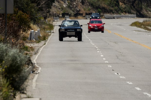 Residents along La Tuna Canyon Road fear driving or bicycling on their own street, a relatively sleepy drag in Sun Valley where drivers are often speeding and drive aggressively. Bicyclists do not feel comfortable riding along the bike lanes that are painted on the road. At this section of La Tuna near the 210 freeway there is no bicycle lane and no shoulder for cyclists, or cars to escape to. (Photo by David Crane/Los Angeles Daily News-SCNG)