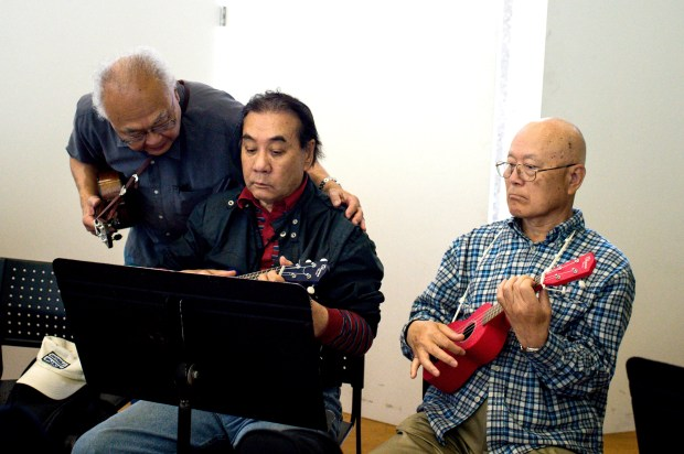 Bob Takata, who helps teach Ukes for Little Tokyo, gives assistance to a player during the weekly class at the Japanese American Cultural and Community Center on Thursday, April 26, 2018. The weekly Japanese language ukulele class for seniors is in its second year at the JACCC. (Photo by Sarah Reingewirtz, Pasadena Star-News/SCNG)