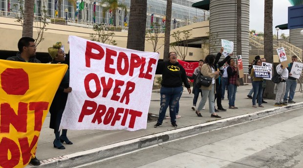 Tenant rights activists rallied for rent control outside an apartment owners conference at the Long Beach Convention Center on May 15, 2018. (Photo by Jeremiah Dobruck, Press-Telegram/SCNG)