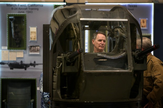 A museum guest can be seen through a gun turret from a B-24 Liberator on display at March Field Air Museum. (File photo)
