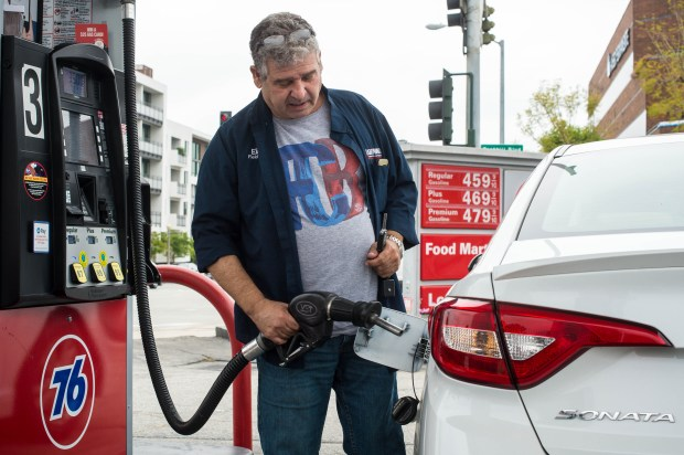 Eilon Reches fills his tank at the Union 76 gas station on East Foothill Boulevard in Pasadena on Wednesday, May 23, 2018. Southern California gas prices continue to rise before Memorial Day weekend and one industry expert predicts this will be the priciest summer in four years. (Photo by Sarah Reingewirtz, Pasadena Star-News/SCNG)