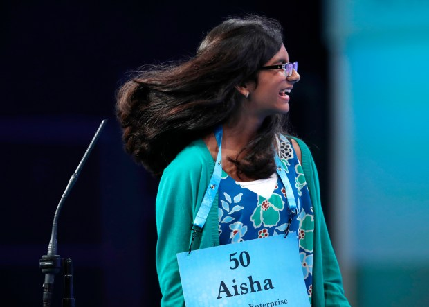 Aisha Randhawa, 12, from Corona, Calif., reacts to spelling a word correctly in the finals of the Scripps National Spelling Bee in Oxon Hill, Md., Thursday, May 31, 2018. (AP Photo/Carolyn Kaster)