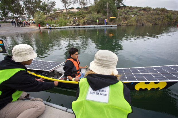 The Perris Union High School District team helps launch its boat, driven by Johan Aguayo, on Friday, May 18, at the annual Solar Cup competition at Lake Skinner.(Photo by Andrew Foulk, contributing photographer)