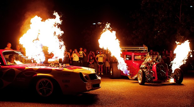 Vehicles light up the night during Show & Go in 2014. This year's event happens Friday and Saturday. (File photo)