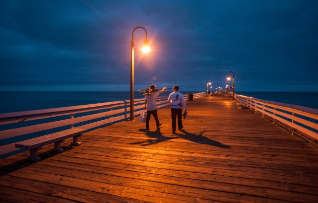 Fishermen walk along the San Clemente Pier just before dawn for a morning of fishing. A marine layer hangs low along the coast until mid morning. (Photo by MARK RIGHTMIRE, ORANGE COUNTY REGISTER/SCNG)