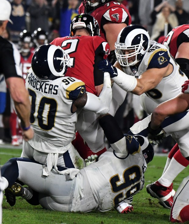 Rams defensive tackle Michael Brockers (90) sacks Atlanta Falcons quarterback Matt Ryan in the first half of a Wild Card NFL playoff game at the Los Angeles Memorial Coliseum on Sunday, Jan. 06, 2018 in Los Angeles. (Photo by Keith Birmingham, Pasadena Star-News/SCNG)