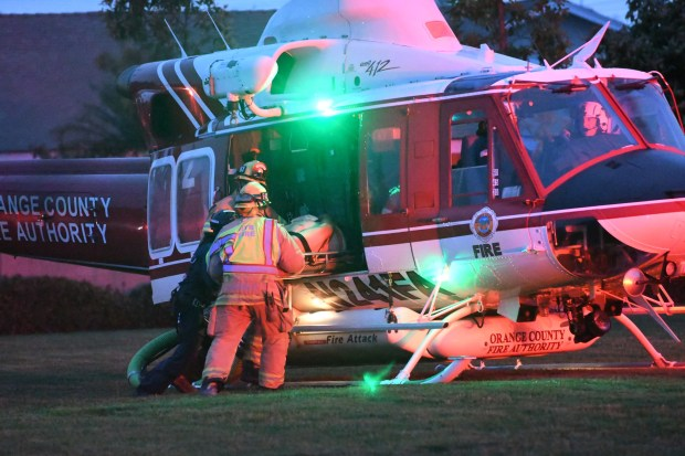 Firefighters place an injured victim into an Orange County Fire Authority helicopter on the grounds of Pegasus Elementary School in Huntington Beach after two vehicles were involved in an accident involving Southern California Edison poles, causing a power outage.Photo by Richard Koehler, contributing photographer.