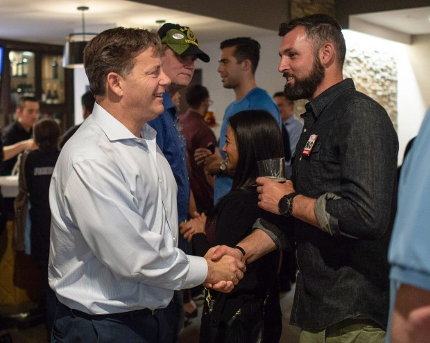 State Sen. Josh Newman, left, greets his supporters during his election night gathering at Embassy Suites in Brea on Tuesday, June 5, 2018. (Photo by Kyusung Gong/Contributing Photographer)