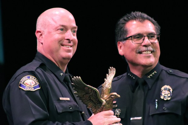 Commander Michael Lewis accepts his Excellence in Leadership Award from Long Beach Police Chief Robert Luna on Thursday evening at the Carpenter Center, part of the Long Beach Police Foundation's 50th Annual Police Awards Ceremony. Photo: Tom Bray, SCNG
