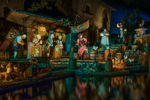 The Disneyland attraction Pirates of the Caribbean reopened Friday, June 8, after it was revamped to alter a scene in which women were auctioned off as brides. In the new version, a redheaded woman who had been a bridge is now depicted as a pirate and the auction is of goods looted from the local townspeople. (Photo by Joshua Sudock, Disneyland Resort)