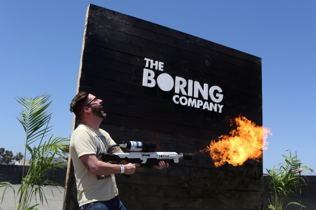 Shaun Roe tests a flamethrower during the Boring Company's Not-a-Flamethrower Party at SpaceX in Hawthorne, California, U.S., on Saturday, June 9, 2018. The event is for people who reserved $1,000 flamethrowers from Elon Musk's Boring Company Photographer: Dania Maxwell/Bloomberg