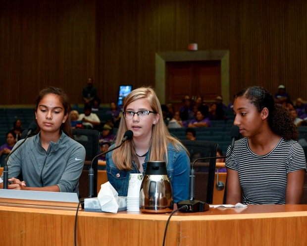 Graves Middle School students (from left) Alison Colacchio, Mone't Carter, and Andrea Prillwitz recently spoke to the Los Angeles County Supervisors that something to be done to make a crosswalk across Meyer Road at Fidel Avenue safer after a classmate was hit by a car there. Photo courtesy Supervisor Janice Hahn's office.