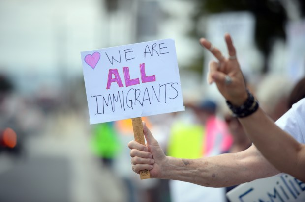 Protesters gather on Hawthorne Boulevard near the South Bay Galleria in Redondo Beach on Saturday, June 30, 2018, joining similar protests all over California and the nation to protest President Trump's immigration policies, particularly separating immigrant parents from their children. (Photo by Axel Koester, Contributing Photographer)