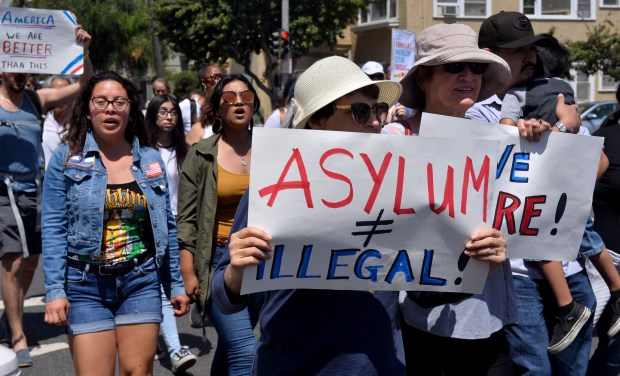 Hundreds gathered at Cesar Chavez Park in Long Beach on Saturday, June 30, 2018 then marched to 501 W Ocean Boulevard, in protest of the Trump administration policy of separating children from their families at the border. (Photo by Brittany Murray, Press Telegram/SCNG)