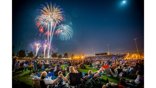 Celebrating July 4th at a professional fireworks show. (File photo by EricReed/SCNG)
