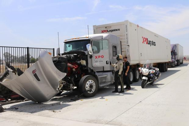 A damaged Kenworth tractor-trailer rig was nearby the AMR ambulance that law enforcement chased. (Courtesy Dan Cupido)