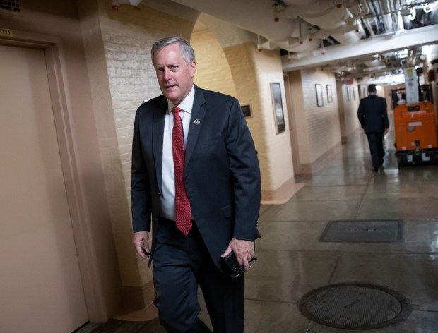 Rep. Mark Meadows, R-N.C., left, chairman of the conservative House Freedom Caucus, walks to a closed-door conference with fellow Republicans the day after they met with President Donald Trump to discuss a GOP immigration bill on Wednesday, June 20, 2018. (AP Photo/J. Scott Applewhite)