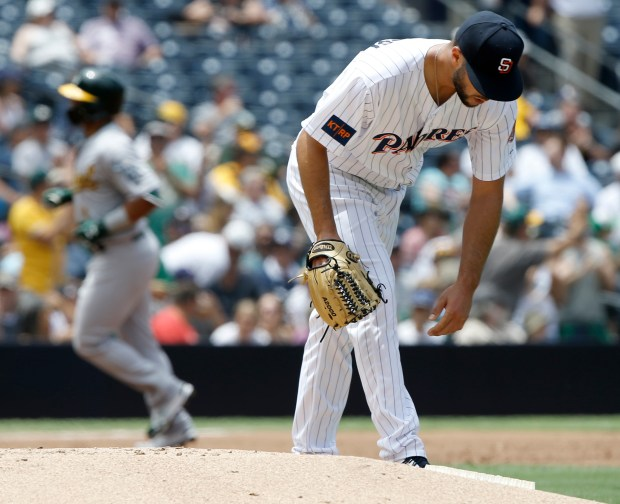 San Diego Padres starting pitcher Joey Lucchesi, right, reaches down at the mound as Oakland Athletics' Franklin Barreto circles the bases after hitting a three-run home run during the second inning of a baseball game in San Diego, Wednesday, June 20, 2018. (AP Photo/Alex Gallardo)