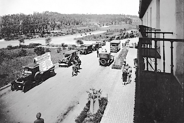 Autos participating in the July 31, 1926, parade celebrate the dedication of the Coast Road in Malaga Cove Plaza.