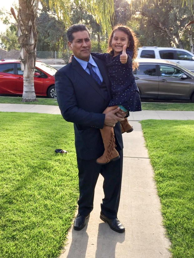 A file photo of Jose Luis Garcia with his grand daughter Marley Hodges, 6. Garcia, a green card holder, was detained by immigration authorities a week before Father's day. (Photo by David Crane, Daily News/SCNG)