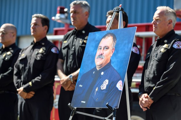 A portrait of Long Beach Fire Captain David Rosa, 45, during a press conference after he was shot and killed responding to a fire in Long Beach, CA, on Monday, June 25, 2018. Rosa and another firefighter were struck by gunfire while responding to reports of an explosion at a downtown Long Beach high-rise. (Photo by Jeff Gritchen, Orange County Register/SCNG)
