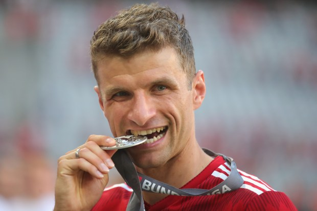 Thomas Mueller of Bayern Muenchen celebrates winning the German Championship title after the Bundesliga match between FC Bayern Muenchen and VfB Stuttgart at Allianz Arena on May 12, 2018 in Munich, Germany. (Photo by Alexander Hassenstein/Bongarts/Getty Images)
