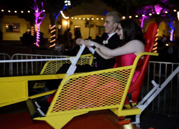 Riley McCoy and her date, Jimmy Quick, go for a carnival ride during the Dana Hills prom.(Photo by Bill Alkofer, Contributing Photographer)