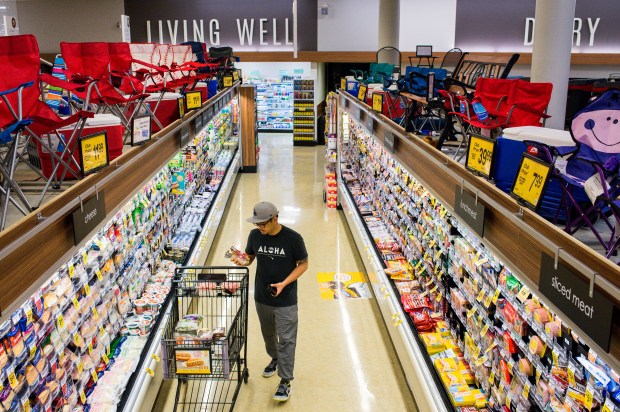 Jose Gavieres shops at Vons supermarket in east Pasadena on Tuesday, June 26, 2018. An industry expert says there is a veritable treasure trove on the top shelves of stores for consumers in search of a bargain. (Photo by Sarah Reingewirtz, Pasadena Star News/SCNG)