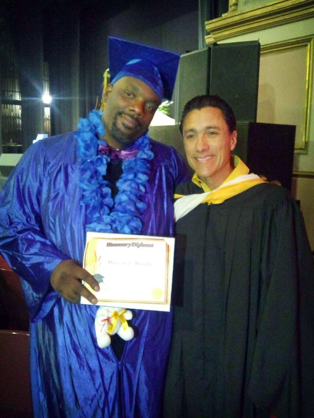 Marcus Woods, 40, of Norwalk, poses for a photo with Hector Murrieta. Woods was recently surprised with a cap and gown and allowed to walk during Sierra High School's graduation in San Bernardino as a thank you for his dedication to the school's students. (Photo courtesy of Gloria Amaya)
