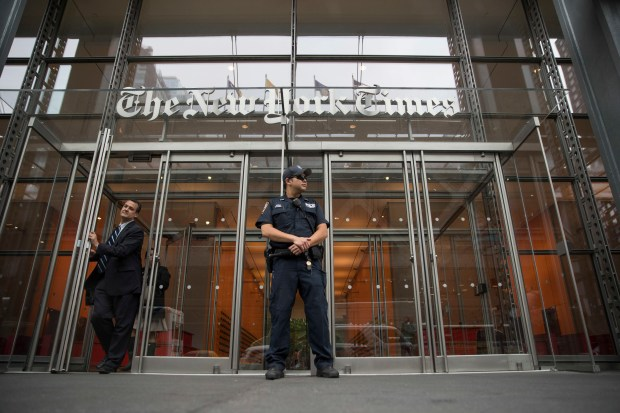 A police officer stands guard outside The New York Times building in New York on Thursday, June 28. The New York Police Department sent patrols to major news media organizations in response to shooting at the Capital Gazette newspaper offices in Annapolis, Md. (AP Photo/Mary Altaffer)
