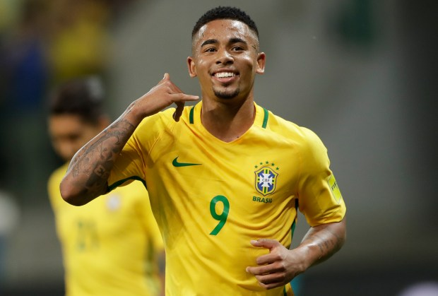 "In this Oct. 10, 2017 photo, Brazil's Gabriel Jesus celebrates with his famous ""Alo Mae"" pretend phone call to his Mom, after scoring against Chile, during a World Cup qualifying soccer match in Sao Paulo, Brazil. (AP Photo/Andre Penner)"