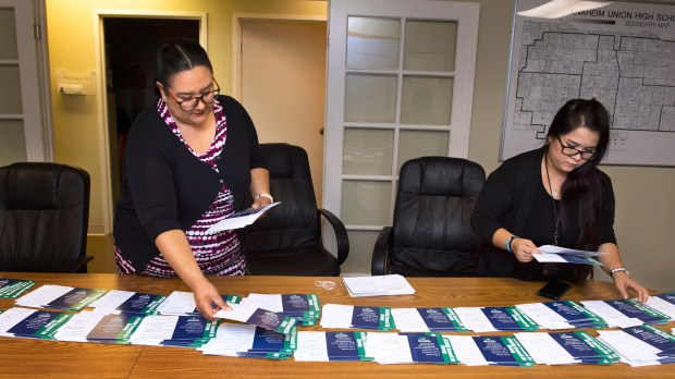 Diana Corral, president of AFSCME Local 2076, left, and Chief Steward Hanh Le, organize cards for members to recommit to their union membership. (Photo by Paul Bersebach, Orange County Register/SCNG)