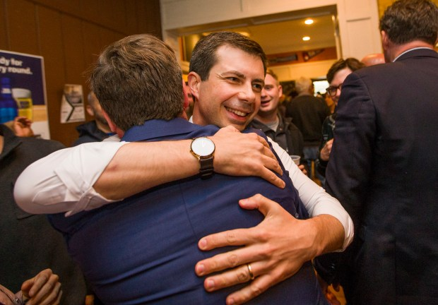 In this Tuesday, May 7, 2019 photo, outgoing South Bend Mayor and Democratic presidential candidate Pete Buttigieg, right, hugs and congratulates James Mueller after Mueller won the democratic primary for South Bend Mayor in South Bend, Ind. (Robert Franklin/South Bend Tribune via AP)