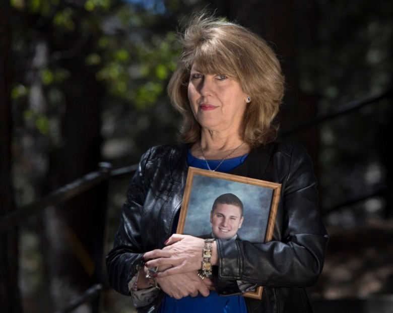 Public Safety Advocate Wendy McEntyre founded the nonprofit Jarrod's Law after her son, Jarrod Autterson, died at age 23 of an overdose in a sober living home. She holds his high school graduation photo. (Photo by Mindy Schauer, Orange County Register/SCNG)