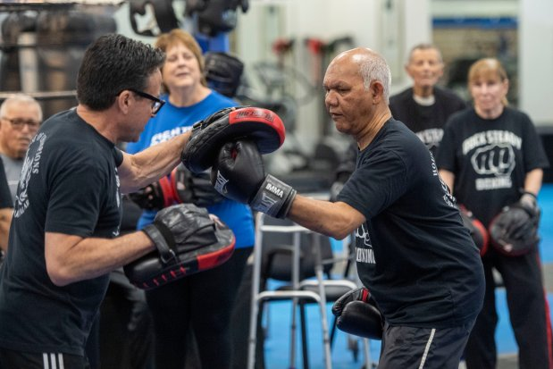 Boxing-style regimen gives these Parkinson's patients a brief, sweaty respite from the disease