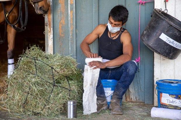 At Santa Anita racetrack, coronavirus cuts off horse caretakers from outside world