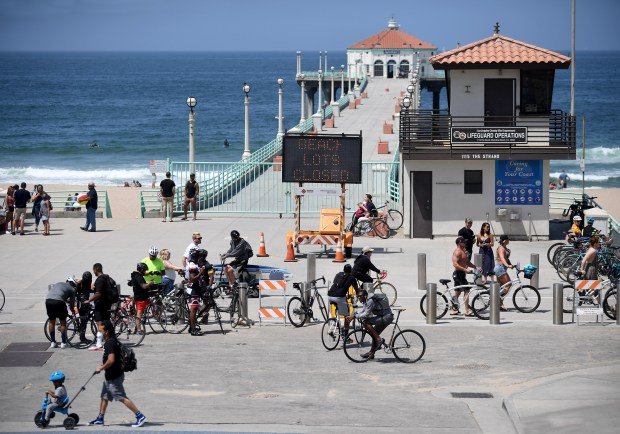 At Southern California beaches, heat, holiday and eased rules put more people on the sand
